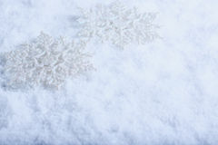 Two beautiful sparkling vintage snowflakes on a white frost snow background. Winter and Christmas concept Stock Photo