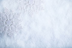 Two beautiful sparkling vintage snowflakes on a white frost snow background. Winter and Christmas concept.  stock photography