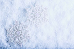 Two beautiful sparkling vintage snowflakes on a white frost snow background. Winter and Christmas concept Royalty Free Stock Image