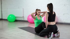 Two beautiful sport woman doing fitness exercise. In fitness centre stock video