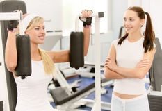 Two beautiful sportwomen make Royalty Free Stock Image