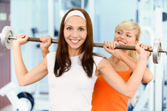 Two beautiful sportwomen make Royalty Free Stock Photography