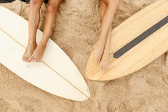 Two beautiful sporty surfer girl at the beach. Royalty Free Stock Photography