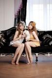 Two beautiful stylish girls with a rabbit Stock Photography