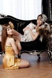 Two beautiful stylish girls with a rabbit Stock Photo