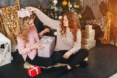 Girls and Christmas stock images