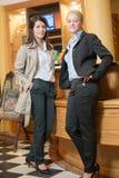 Two beautiful stylish women Stock Photos