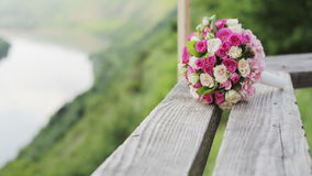 Two beautiful summer bridal bouquet lying on a park bench, wedding day, celebration and friendship take it.  stock video