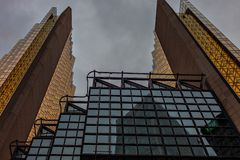 Two beautiful symmetrical buildings in the city center.Modern architecture downtown Toronto. stock photography