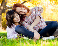 Two beautiful teen girl at green grass Stock Image