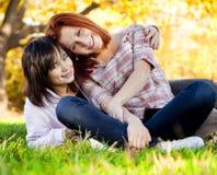 Two beautiful teen girl at green grass Stock Image