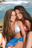 Two beautiful teenage girls on the beac stock photos