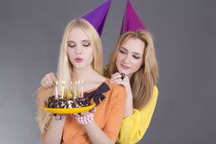 Two beautiful teenage girls with birthday cake Royalty Free Stock Images