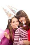 Two beautiful teenage girls celebrating Royalty Free Stock Image