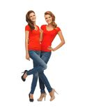 Two beautiful teenage girls in red t-shirts Royalty Free Stock Photo