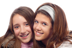 Two beautiful teenage girls smiling Royalty Free Stock Photography