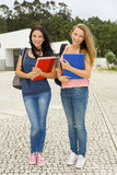 Two beautiful teenage students Stock Images