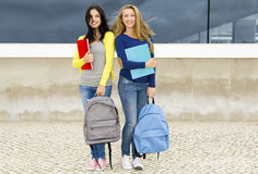 Two beautiful teenage students Royalty Free Stock Image