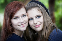 Two beautiful teens smiling Stock Photos