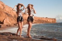 Free Two Beautiful Twins Girl In Straw Hat Having Fun On The Beach Enjoying Life, Summer Sunset Outdoor Portrait. People Girlfriend Stock Photo - 203811300