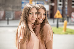 Two beautiful twins sisters spending time together. Royalty Free Stock Photography