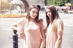 Two beautiful twins sisters spending time together. Royalty Free Stock Photos