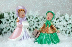 Two beautiful vintage carol singers Stock Photo