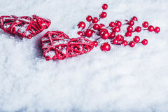 Two Beautiful Vintage Red Hearts With Mistletoe Berries On A White Snow Background. Christmas, Love And St. Valentines Day Concept