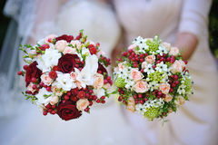 Two beautiful wedding bouquet with red flowers Stock Photo