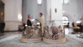 Two beautiful wedding crowns in church. HD stock video