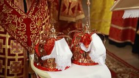 Two beautiful wedding crowns in church. Ukraine stock video