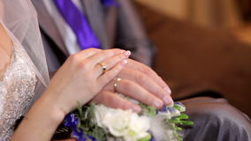 Two beautiful wedding ring on a dark purple background.  stock footage