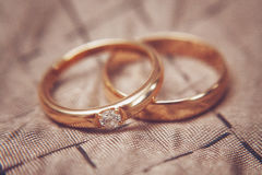 Two beautiful wedding rings with brilliants, vintage toned Stock Photography