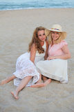Two beautiful woman best friends on beach having fun Royalty Free Stock Photos