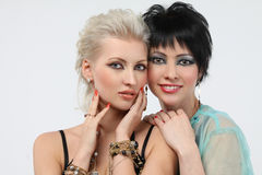 Two beautiful woman - blonde and brunette Royalty Free Stock Photography