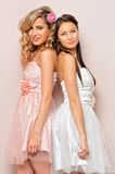 Two beautiful woman in chic dresses. Royalty Free Stock Image