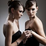 Two beautiful woman with jewelry Royalty Free Stock Photos