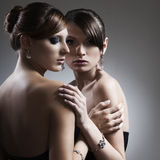 Two beautiful woman with jewelry Royalty Free Stock Photo