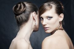 Two beautiful woman with jewelry Royalty Free Stock Images