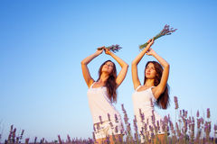 Two beautiful woman on lavender field Royalty Free Stock Photo