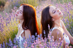 Two beautiful woman on lavender field Royalty Free Stock Photography