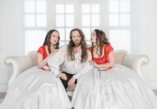 Two beautiful woman and man in medieval costumes royalty free stock photos
