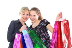 Two beautiful woman with a shopping bags. Isolated on white. Royalty Free Stock Photo
