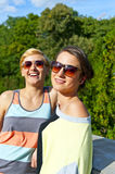 Two  beautiful woman with sunglasses on natural background Stock Image