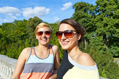 Two  beautiful woman with sunglasses on natural background Stock Photo