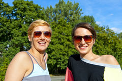 Two  beautiful woman with sunglasses on natural background Stock Photos