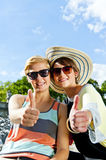 Two  beautiful woman with sunglasses on natural background Royalty Free Stock Photos