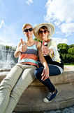 Two  beautiful woman with sunglasses on natural background Stock Photography