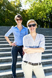 Two  beautiful woman with sunglasses on park Royalty Free Stock Images