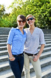 Two  beautiful woman with sunglasses on the stairs Stock Photos